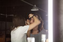 Makeup artist at work. Backstage photo of makeup artist at work Royalty Free Stock Images