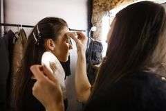 Makeup artist at work. Backstage photo of makeup artist at work Royalty Free Stock Photo