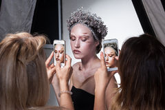 Backstage photo of model wearing creative makeup Royalty Free Stock Photo