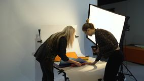 Backstage photo teamwork brainstorming stylist. Backstage photography. teamwork brainstorming. photo stylist creative work process. setting the objects royalty free stock photography