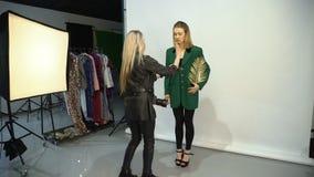 Backstage fashion photographer stylist creative stock video