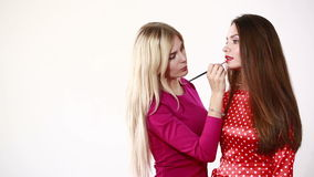 Backstage scene: Professional Make-up artist doing glamour model makeup at work stock video footage