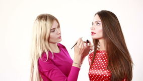 Backstage scene: Professional Make-up artist doing glamour model makeup at work stock footage