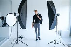 Backstage man workplace photo studio concept. Backstage self-confident man equipment workplace photo studio concept. Photography of fashion look royalty free stock photos