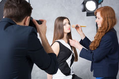 Backstage of a studio beauty session Stock Photos