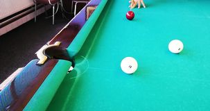 Russian billiards. Interesting beats. Backstay. Outhaul. To pull off. Blow in Russian billiards when your `own` ball after a collision with a `stranger` spins stock footage