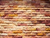 Backsteinmauer-Beschaffenheitshintergrund der Unschärfe bunter Lizenzfreies Stockfoto