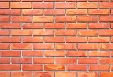Backsteinmauer in der orange und gelben Farbe Stockfotografie