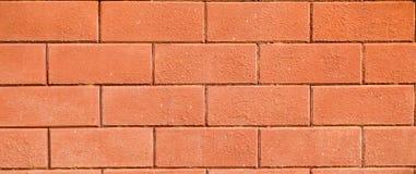 Backsteinmauer des Straßenrandgebäudes Lizenzfreies Stockfoto