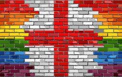 Backsteinmauer England und homosexuelle Flaggen Stockbilder