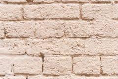 Backsteinmauer gemalt stockbild