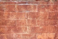 Backsteinmauer gemasert stockbilder