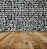 Backsteinmauer, hölzerner Boden. Stockfotografie