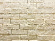 Backsteinmauer im weichen Ton Stockfoto