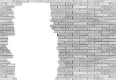 Backsteinmauer mit dem Loch lokalisiert auf weißem Hintergrund Lizenzfreies Stockfoto
