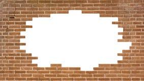 Backsteinmauer mit einem großen Loch Stockfotografie