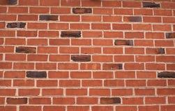 Backsteinmauer mit etwas Klinkern Lizenzfreie Stockbilder