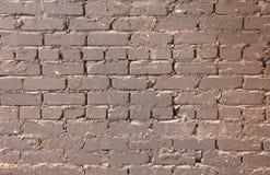 Backsteinmauer mit Farbe Stockbilder