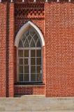 Backsteinmauer mit Fenster Stockbild
