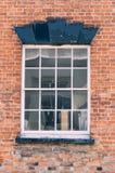 Backsteinmauer mit Fenster Lizenzfreies Stockbild