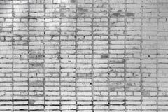 Backsteinmauer, mit Flecken Beschaffenheit der Maurerarbeit Schöner leerer Hintergrund von grauen Ziegelsteinen Lizenzfreie Stockfotos