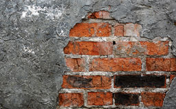 Backsteinmauer mit Gips Lizenzfreies Stockfoto