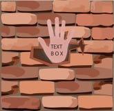 Backsteinmauer mit seiner Hand, Stockfotografie