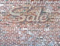 Backsteinmauer mit Verkaufs-Geist-Zeichen Stockfoto