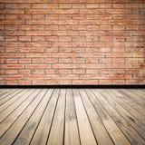 Backsteinmauer und hölzerner Boden Lizenzfreies Stockfoto