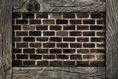 Backsteinmauer und Holzrahmen Lizenzfreies Stockfoto