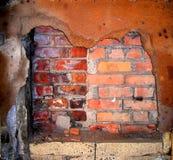 Backsteinmauer und Rost Stockfotografie