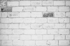 Backsteinmauer, weiße Farbe, Tapete oder Hintergrund mit Platz für Text Stockfotografie