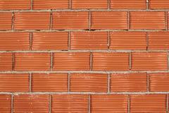 Backsteinmaueraufbau airbrick des roten Lehms Stockfoto