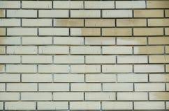 Backsteinmauerbeschaffenheit des gelben Steins blockiert abstrakten Hintergrund der Nahaufnahme Stockbilder