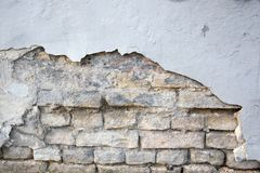 Backsteinmauerbeschaffenheit und bestrahlter Gips Lizenzfreie Stockfotografie
