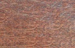 Backsteinmauerbeschaffenheitszusammenfassungsrauer roter Steinfassaden-Strukturhintergrund Lizenzfreie Stockbilder