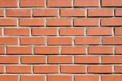 Backsteinmauerhintergrund, Beschaffenheit des roten Steins blockiert Nahaufnahme Stockfotografie
