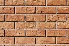 Backsteinmauerhintergrund mit Dunkelorange lizenzfreie stockbilder