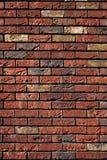 Backsteinmauerrot mit Gelb Lizenzfreies Stockbild