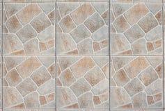 Backsteinmauersteinfliesenhintergrund Stockbilder