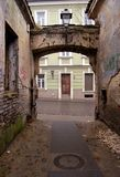 Backstreet. Empty desolated backstreet and arch in Vilnius old town, Lithuania Stock Images