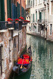 Backstreet canal Venice with empty gondola Royalty Free Stock Photography