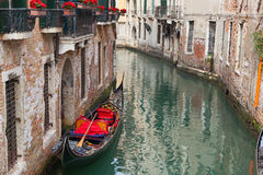 Backstreet canal Venice with empty gondola Stock Photos