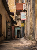 Backstreet. Old street with repair shops Royalty Free Stock Images