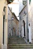 Backstreet in old town of Herceg Novi, Montenegro Stock Photos