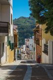 Backstreet of Teror town, Gran Canaria, Spain. Teror, Spain - February 27, 2018: One of the attractive streets in Teror, popular tourist destination on Gran Royalty Free Stock Image
