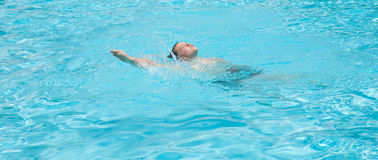 Backstroke. Cute little boy swimming on his back Stock Photography