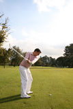 Backswing. Young golfer taking a backswing on the golf course during a round of golf Royalty Free Stock Photo