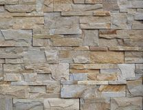 Background and texture. Modern wall made of natural gray and brown stones stock photography