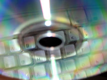 Backup. Keyboard reflected in cd stock photos